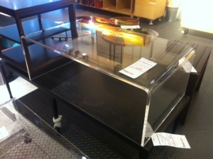 CB2 acrylic coffee table at outlet