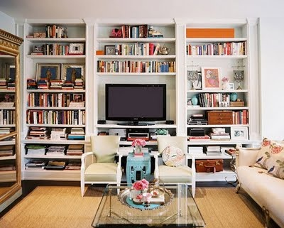 bookshelves with tv in center