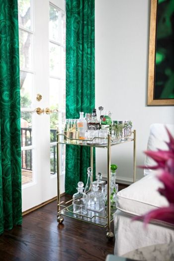 malachite drapes and brass bar cart