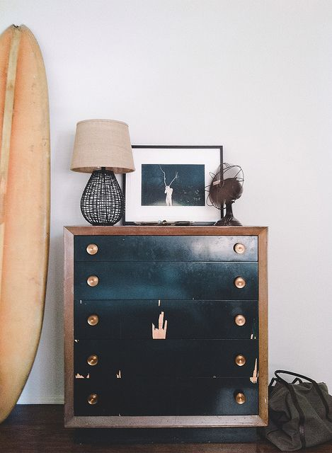 black and wood dresser with brass pulls